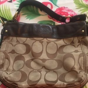 Authentic Coach bag with leather and brass